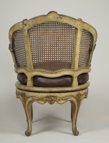 Seating  - Carved and lacquered walnut spinning chair with cane attributed to Nogaret