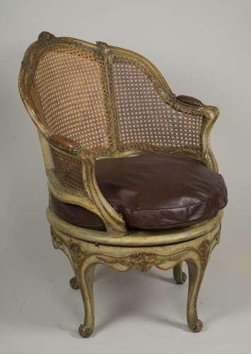 Carved and lacquered walnut spinning chair with cane attributed to Nogaret - Louis XV
