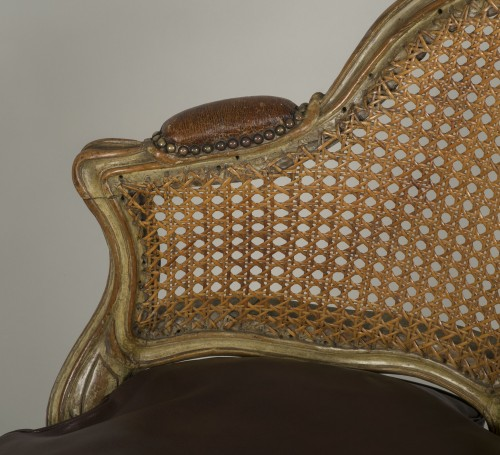 Antiquités - Carved and lacquered walnut spinning chair with cane attributed to Nogaret