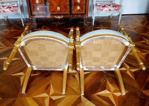 Antiquités - Pair of gilt wood armchairs - France circa 1796-1799