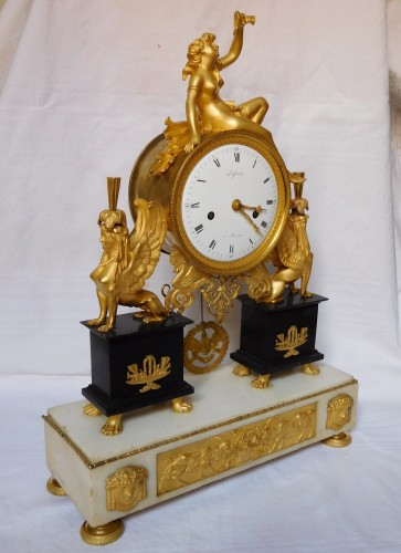 Clocks  - French late 18th century ormolu and marble clock