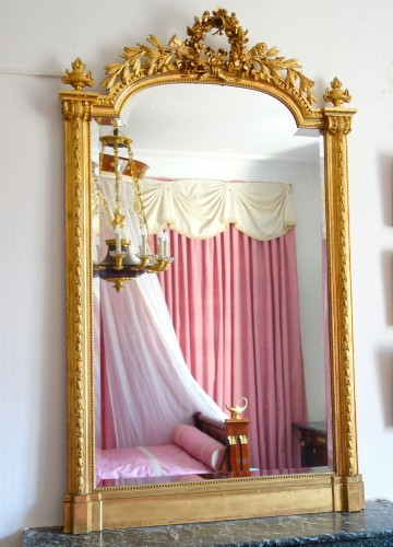 Mirrors, Trumeau  - A late 19th century gilt wood mirror