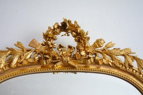 19th century - A late 19th century gilt wood mirror