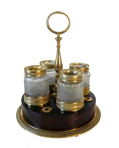An Empire inkwell in gilt bronze and mahogany by Ravrio