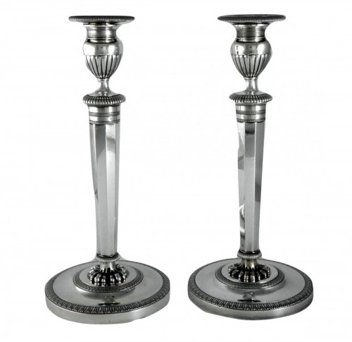 Pair of Empire candlesticks by Ravrio