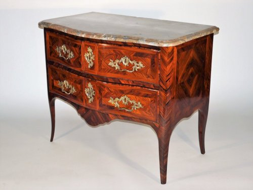 A Régence chest of drawers stamped by Marchand -