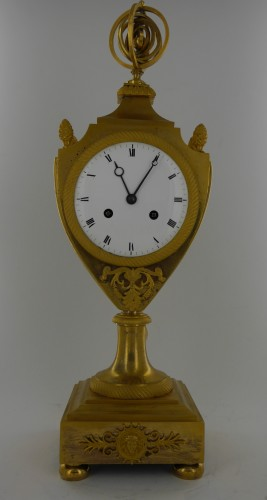 Clocks  - An Empire clock, eary 19th century