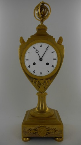 Antiquités - An Empire clock, eary 19th century