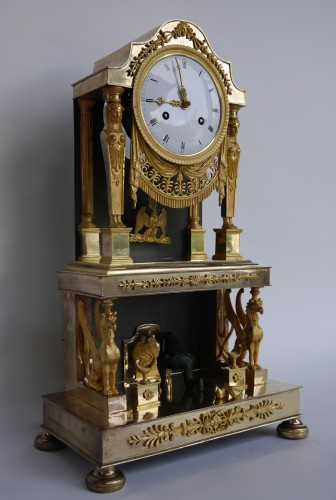 Gilt bronze clock of Consulate period -