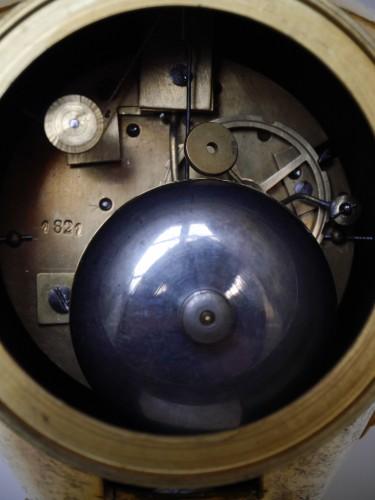 Clocks  - Bronze and porcelain pendulum clock vase of Directoire Period