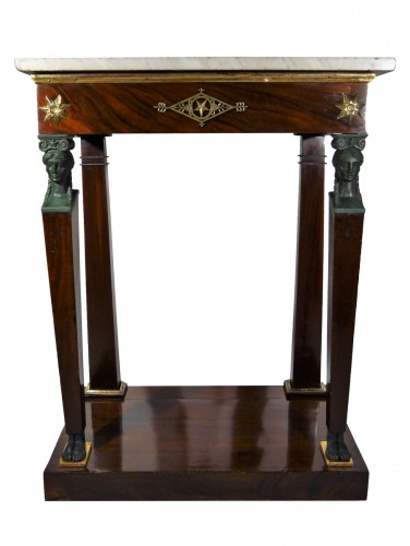 A small Empire console