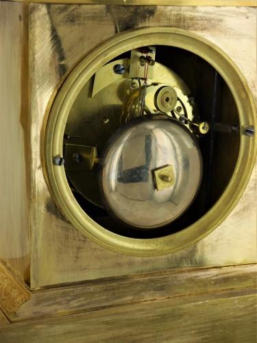 19th century - A gilt bronze pendulum clock, beginning of the 19th century