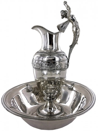 An ewer and its basin in silver, Empire style, 19th century