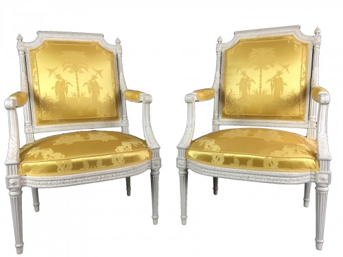 A pair of Louis XVI armchairs by Chevigny