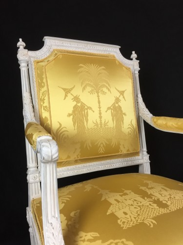 A pair of Louis XVI armchairs by Chevigny -