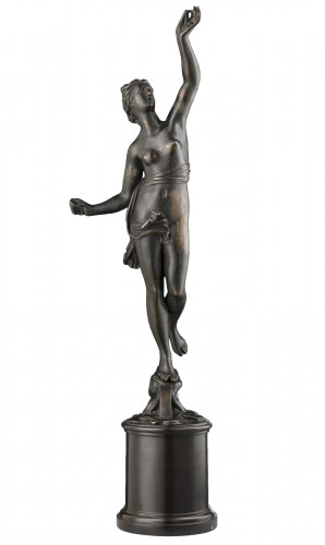 A bronze of a standing female nude