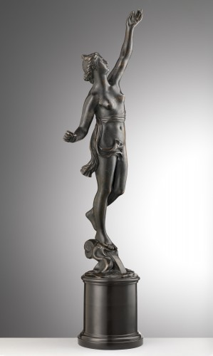 A bronze of a standing female nude -