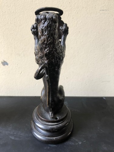- Pair of bronze lions holding a coat of arms