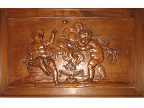 A mid 18th century carved wood panel