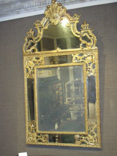 "A french Regence giltwood mirror ""à parecloses"""