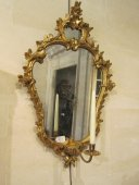 A Louis XV pair of gilded wood mirrors