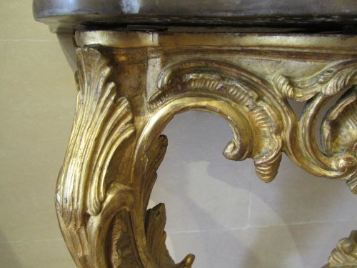 A pair of Louis XV giltwood console tables -