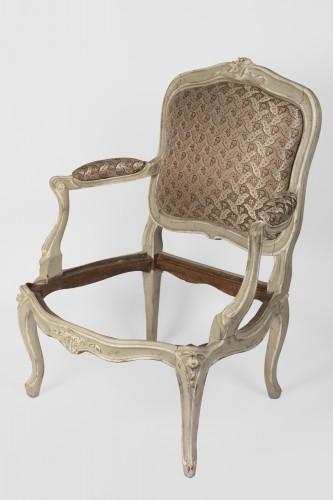A pair of Louis XV painted fauteuils à la Reine -