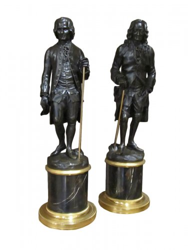 A pair of Louis XVI patined bronze of Voltaire and Rousseau