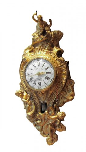 A french Louis XV ormolu striking cartel clock stamped A Thiout