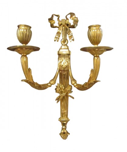 A pair of gilt bronze wall lights Louis XVI