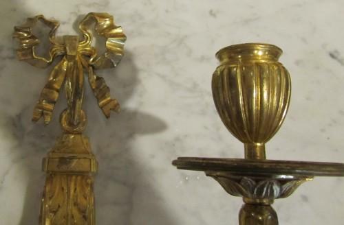 Antiquités - A pair of gilt bronze wall lights Louis XVI