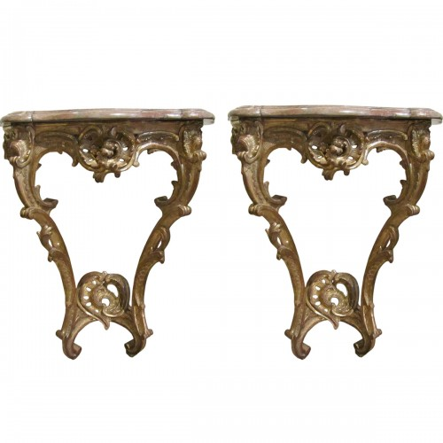 A pair of  Louis XV gilt-wood consoles