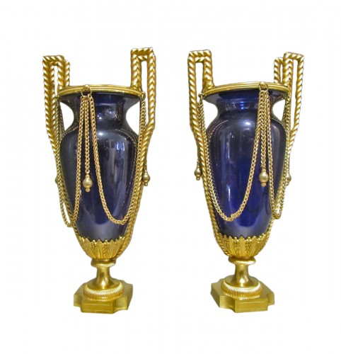 A pair of Louis XVI gilt- bronze and Creusot blue tinted glass