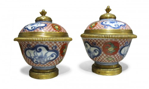 A pair of Régence ormolu-mounted Japanese pots