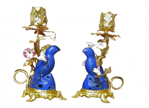 A pair of Louis XV gilt-bronze and porclaines clandesticks