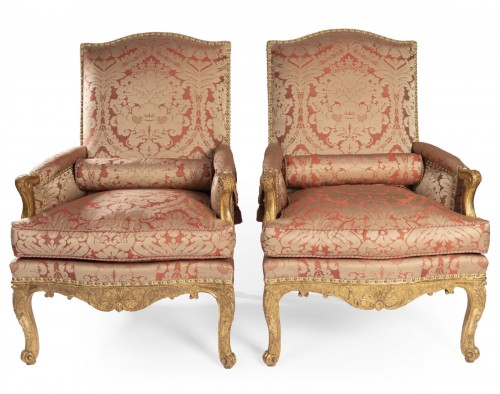 A pair of Regence giltwood Bergeres