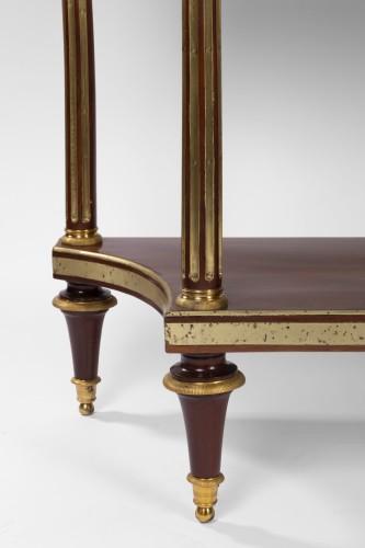 A pair of Louis XVI mahogany consoles dessertes -