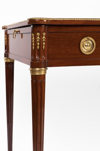 Furniture  - A Louis XVI brass-mounted Mahogany Bureau Plat