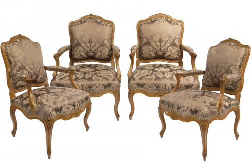 A set of four Louis XV  fauteuils à la Reine stamped Henri Amand