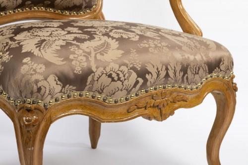 A set of four Louis XV  fauteuils à la Reine stamped Henri Amand -