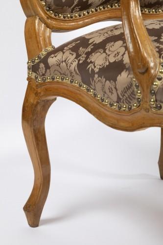 A set of four Louis XV  fauteuils à la Reine stamped Henri Amand - Louis XV