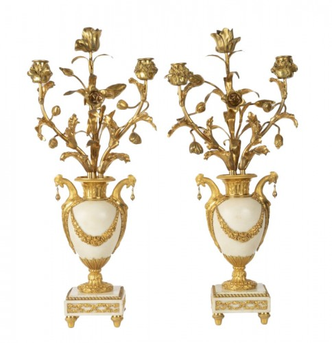 A pair of ormolu Louis XVI three lights Candelabra