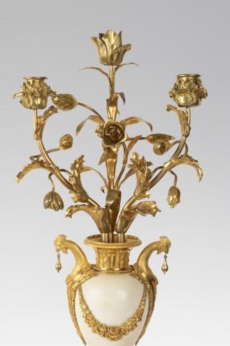Louis XVI - A pair of ormolu Louis XVI three lights Candelabra