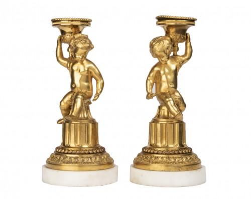A Pair of Louis XVI ormolu mounted Candlesticks