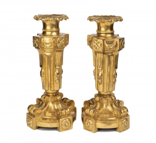 A pair of Louis XVI ormolu candelabra