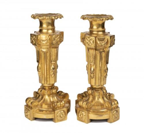 A pair of Louis XVI ormolu candelabra