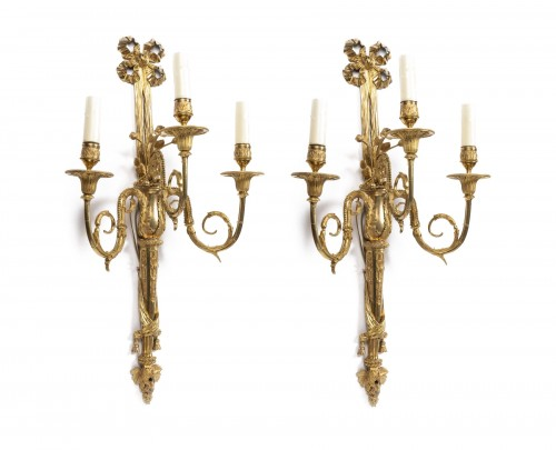 A pair of Louis XVI gilt -bronze wall lights