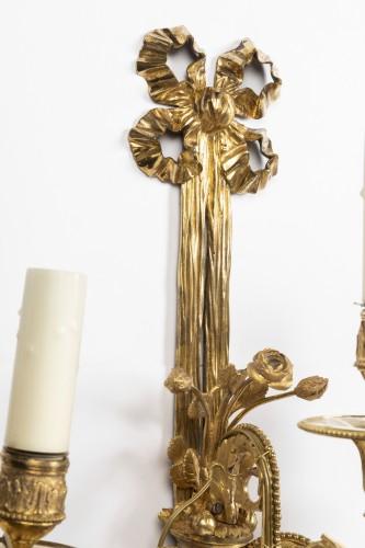 Antiquités - A pair of Louis XVI gilt -bronze wall lights