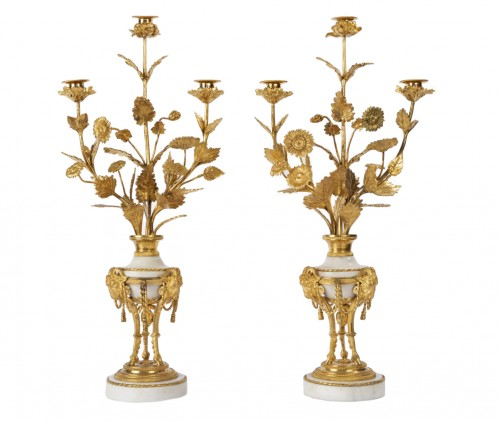 A pair of Louis XVI ormolu-mounted Atheniennes Candelabra