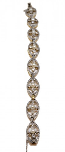 Bracelet in gold, platinum, diamonds and pearls